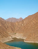 Mountains in the Dubai Desert. Hatta Dam Lake with mountains in the background Stock Images