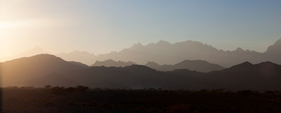 Mountains at dusk. Rays of light across mountains at dusk Stock Photo