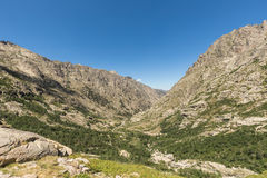Mountains either side of Restonica valley in Corsica Stock Images