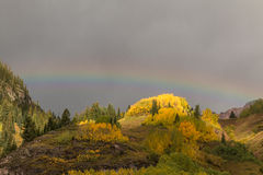 Mountains in Fall With Rainbow Royalty Free Stock Images