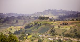 Mountains and farms in the highlands of Ethiopia. Mountains, farms, and houses in the highlands of Ethiopia Royalty Free Stock Photos