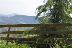 Mountains and a fence. Meadow in the Caucasus - a log fence and countains Royalty Free Stock Photos