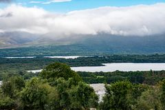 Mountains, Fields and Lake on Cloudy Day in Killarney Ireland. View of Mountains, Fields and Lake on Cloudy Day in Killarney Ireland Royalty Free Stock Photos