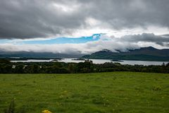 Mountains, Fields and Lake on Cloudy Day in Killarney Ireland. View of Mountains, Fields and Lake on Cloudy Day in Killarney Ireland Stock Image
