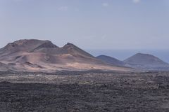 Timanfaya National Park.Ocean in Backgrounds Royalty Free Stock Photos