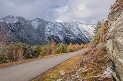 Mountains first snow autumn road Stock Images