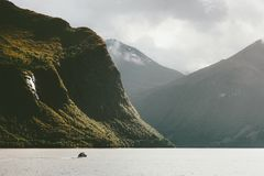 Mountains and fishing boat fjord sea. Wild Landscape in Norway scandinavian Travel Stock Photography