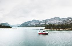 Mountains and fishing boat sea Landscape. Wild nature in Norway scandinavian Travel Royalty Free Stock Photo