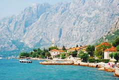 Mountains and fishing boats near town Perast, Kotor bay royalty free stock image
