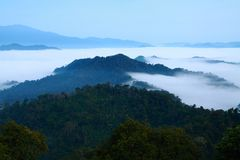 Mountains in the fog. View of far away blue mountains in the fog Stock Image