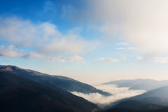 Mountains in fog Stock Images
