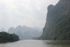 Mountains and fog along Li river. Naturalistic scenes during the cruise on the Li river, Guilin - China stock photos