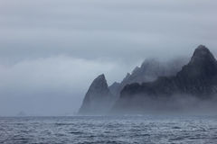 Mountains in fog, Antarctic landscape Stock Images