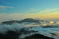 Mountains in a fog Stock Photos