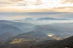 The mountains and the fog dream between them on the horizont.  Royalty Free Stock Photo