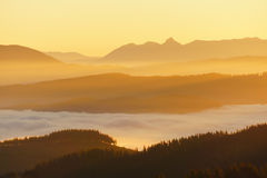 Mountains with fog at sunrise. Mountains with fog at the sunrise Stock Photos