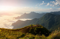 Mountains and fog with sunrise in morning Stock Photo