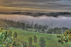 Mountains foggy landscape in HDR Royalty Free Stock Image