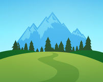 Mountains with Forest and Green Meadow Royalty Free Stock Photos