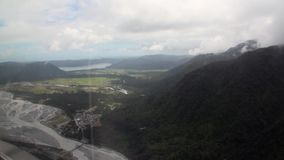 Mountains forest green thick top view from the helicopter window in New Zealand. stock footage
