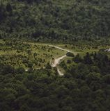 Faraway shot of a winding road through the countryside stock photo