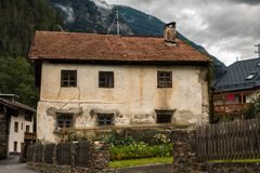 Mountains and old house. Mountains, forest, sky and landscape and old house Royalty Free Stock Photography