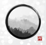 Mountains with forest trees in fog in black enso zen circle on white glowing background. Hieroglyph - zen.Traditional. Oriental ink painting sumi-e, u-sin, go Royalty Free Stock Image