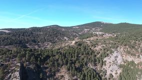 Mountains and forests of Spain from a bird`s eye view. Clear sky above the forest in the mountains.