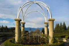 Mountains through a Garden. View of Vancouver's North Shore through a rose garden Royalty Free Stock Image