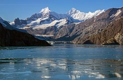Mountains & Glacier-Glacier Bay,Alaska,USA. Snow covered Mountains & Glacier reflecting in ice covered water in Glacier Bay,Alaska,USA Stock Photos