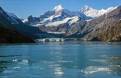 Mountains & Glacier-Glacier Bay,Alaska,USA. Snow covered Mountains & Glacier reflectiong in ice covered sea water in Glacier Bay,Alaska,USA Stock Images