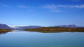 Mountains at glacier lake Langjökull. Mountain reflection in glacier lake Hvitarvatn of the Langjökull glacier in Iceland royalty free stock photos