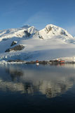 Mountains & glaciers. With research station, Paradise harbor, Antarctica stock photos
