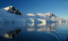 Mountains & glaciers reflected Stock Images