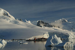 Mountains & glaciers with research station. Paradise harbor, Antarctica Royalty Free Stock Photography