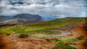 Mountains, green grass, windmills and a cloudy sky. Portugal, Madeira Island, Ponta do Rosto Royalty Free Stock Photo