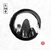 Mountains hand drawn with ink in black zen circle. Mountains hand drawn with ink in black enso zen circle on rice paper background. Traditional Japanese ink Stock Photo