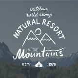 Mountains handdrawn sketch emblem. outdoor camping and hiking activity, Extreme sports, outdoor adventure symbol, vector illustrat Stock Image