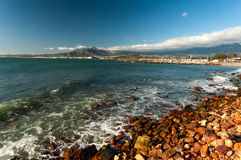 The mountains and harbour at Gordons Bay near Cape Town. Royalty Free Stock Photos