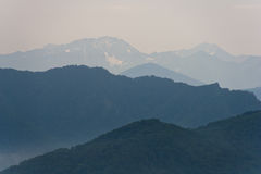 Mountains in haze. Background image. Mountain peaks in evening haze. Background image stock photo