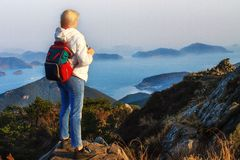 Mountains with heavy backpack Travel Lifestyle wanderlust adventure concept vacations. Woman hiking at sunset mountains with heavy backpack Travel Lifestyle stock photos