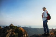 Mountains with heavy backpack Travel Lifestyle wanderlust adventure concept vacations. Woman hiking at sunset mountains with heavy backpack Travel Lifestyle royalty free stock image