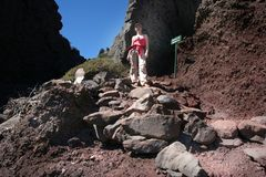 Mountains hiking. Girl hike on the volcanic rocks of La Palma, Canary Islands, West Africa stock photo