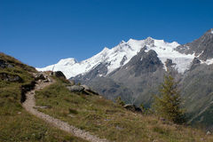 Mountains with Hiking trail in Foreground Royalty Free Stock Image