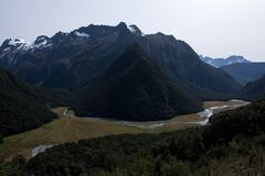 Mountains and hills at the Routeburn Great Walk in Fiordland in New Zealand stock photos