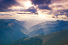 Mountains hills and sunbeams Royalty Free Stock Images