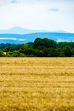 Mountains on horizon. Very faraway mountains on horizon, the view from field over the valley Stock Photos
