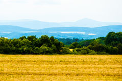 Mountains on horizon. Very faraway mountains on horizon, the view from field over the valley Stock Photo