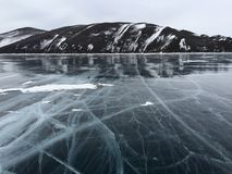 The mountains and the ice of Lake Baikal Stock Images