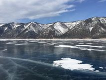 The mountains and the ice of Lake Baikal. Stock Photography